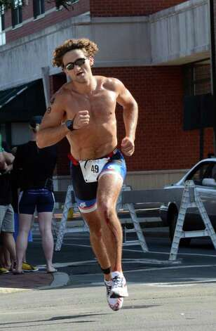 Casey Neistat, of New London, competes in the Stamford KIC IT Triathlon in Columbus Park Sunday June 27, 2010. The race features a mile swim off of Cummings Beach followed by a 24.8 mile bike throughout the city and a 6 mile run finishing at Columbus Park. The event drew more than 500 athletes raising money for Greenwich based Kids in Crisis. Photo: Amy Mortensen / Connecticut Post Freelance