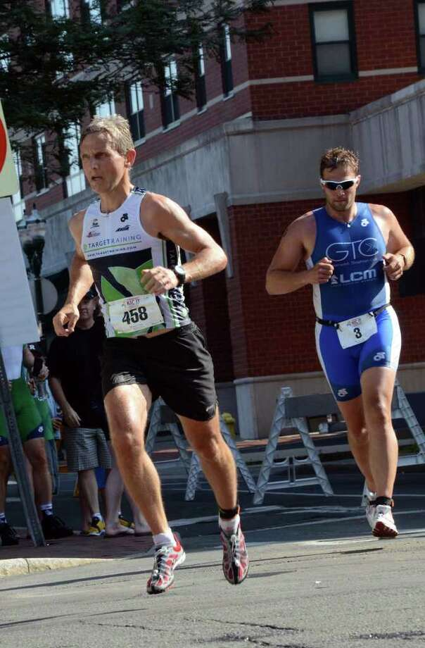 Michael Kirby, of Westport and Michael Ross Armstrong, of Pound Ridge, NY, compete in the Stamford KIC IT Triathlon in Columbus Park Sunday June 27, 2010. The race features a mile swim off of Cummings Beach followed by a 24.8 mile bike throughout the city and a 6 mile run finishing at Columbus Park. The event drew more than 500 athletes raising money for Greenwich based Kids in Crisis. Photo: Amy Mortensen / Connecticut Post Freelance