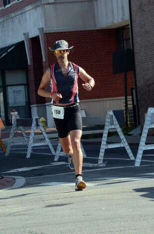 Nicholas-Karim Baddour, of Larchmont, NY, competes in the Stamford KIC IT Triathlon in Columbus Park Sunday June 27, 2010. The race features a mile swim off of Cummings Beach followed by a 24.8 mile bike throughout the city and a 6 mile run finishing at Columbus Park. The event drew more than 500 athletes raising money for Greenwich based Kids in Crisis. Photo: Amy Mortensen / Connecticut Post Freelance