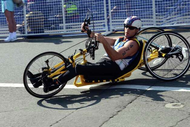 Daniel Tratt, of New Rochelle, NY, competes in the Stamford KIC IT Triathlon in Columbus Park Sunday June 27, 2010. The race features a mile swim off of Cummings Beach followed by a 24.8 mile bike throughout the city and a 6 mile run finishing at Columbus Park. The event drew more than 500 athletes raising money for Greenwich based Kids in Crisis. Photo: Amy Mortensen / Connecticut Post Freelance