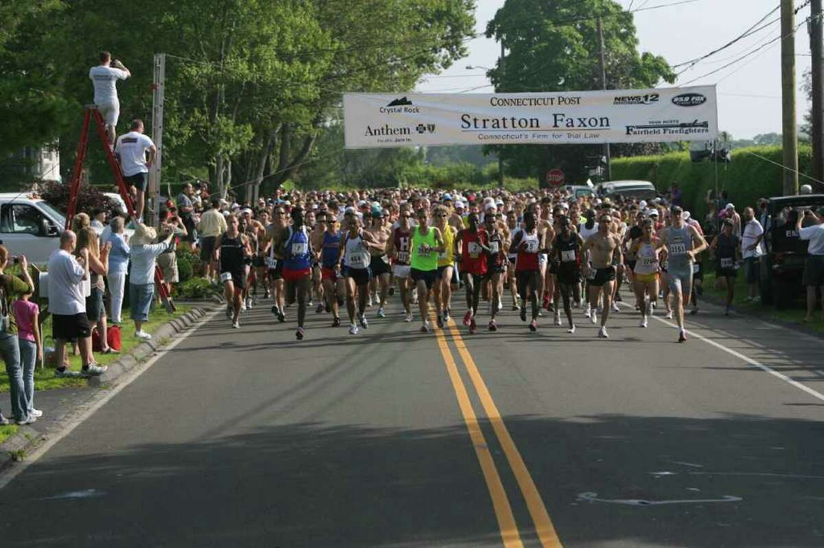 Runners start The Stratton Faxon Fairfield Half Marathon on Fairfield Beach Road on Sunday, June 26, 2011.