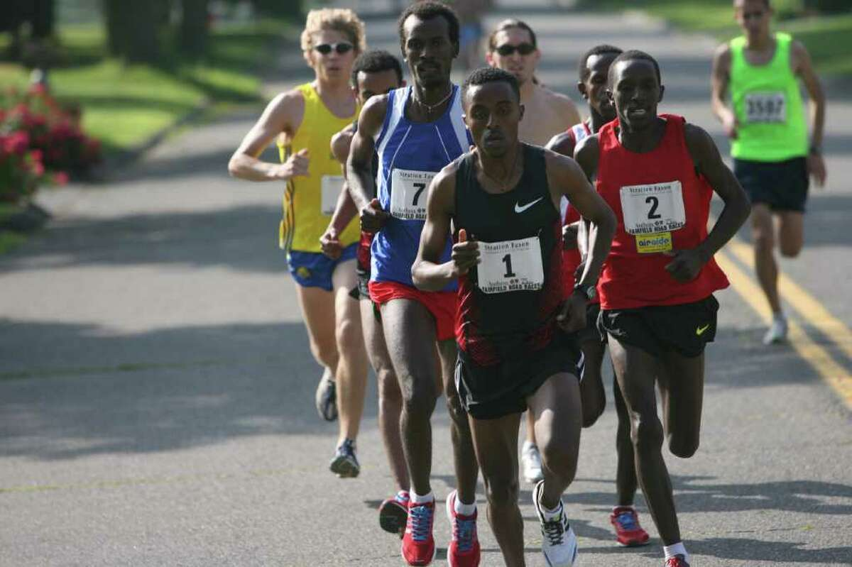 Elite runners pull away from the pack at the start of The Stratton Faxon Fairfield Half Marathon on Fairfield Beach Road on Sunday, June 26, 2011. Worku Beyi,1, of Ethiopia, leads the pack.