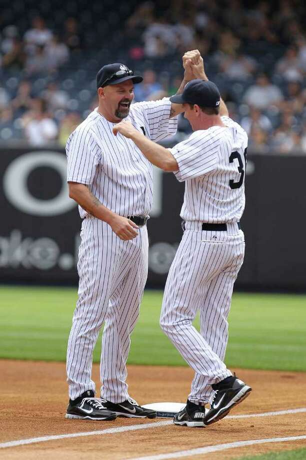 NEW YORK, NY - JUNE 26:  David Wells is met by Davis Cone during The New York Yankees 65th Old Timers Day game on June 26, 2011 at Yankee Stadium in the Bronx borough of New York City.  (Photo by Al Bello/Getty Images) Photo: Al Bello, Getty Images / 2011 Getty Images