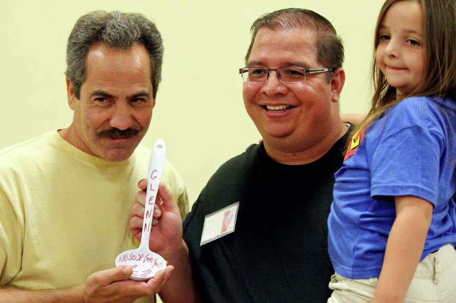 Glenn Weber, 33, (center) and his daughter Gracie Weber, 6, pose for a photo with Larry Thomas (left), who played The Soup Nazi on Seinfeld, during the Texas Comicon 2011 Sunday, June 26, 2011, at the San Antonio Event Center. Photo: PHOTO BY EDWARD A. ORNELAS/eaornelas@express-news.net / © SAN ANTONIO EXPRESS-NEWS (NFS)