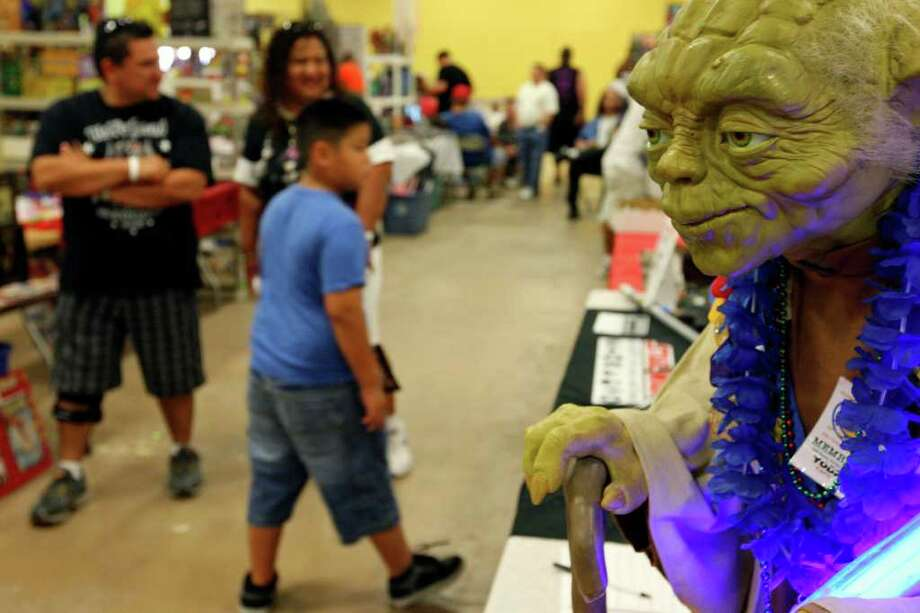 A Yoda model on display at the Star Wars Society of San Antonio booth during the Texas Comicon 2011 Sunday, June 26, 2011, at the San Antonio Event Center. Photo: PHOTO BY EDWARD A. ORNELAS/eaornelas@express-news.net / © SAN ANTONIO EXPRESS-NEWS (NFS)