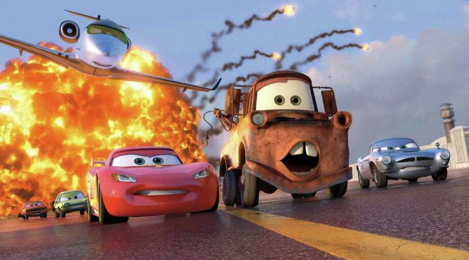 """FILE - In this file film publicity image released by Disney-Pixar, animated characters Lightning McQueen, voiced by Owen Wilson, foreground left, Mater, voiced by Larry the Cable Guy, center, and Finn McMissile, voiced by Michael Caine, right, are shown in a scene from """"Cars 2."""" Cars 2"""" cruised to a No. 1 finish with a $68 million opening weekend, according to studio estimates Sunday, June 26, 2011. That makes 12 wins in a row for Pixar since 1995's """"Toy Story."""" (AP Photo/Disney/Pixar, File)"""