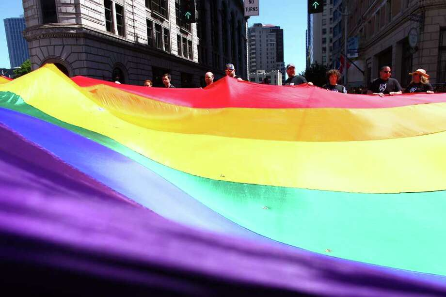 Participants carry the pride flag during the 2011 Seattle Pride Parade on Sunday, June 26, 2011 along 4th Avenue downtown. Tens of thousands of people lined the route of the annual event. Photo: JOSHUA TRUJILLO / SEATTLEPI.COM
