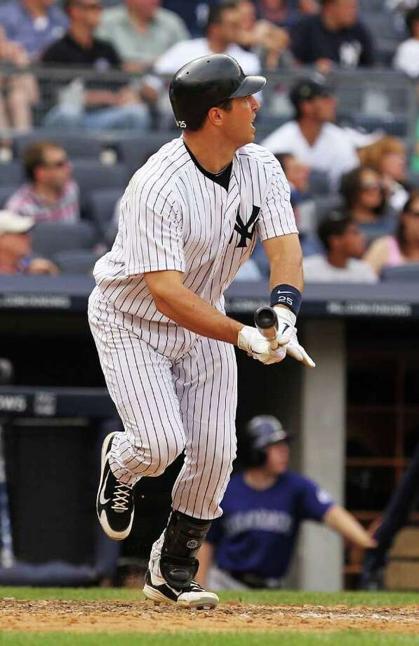 NEW YORK, NY - JUNE 26:  Mark Teixeira #25 of the New York Yankees hits a home run against the Colorado Rockies in the eigth inning during their game on June 26, 2011 at Yankee Stadium in the Bronx borough of New York City.  (Photo by Al Bello/Getty Images) Photo: Al Bello, Getty Images / 2011 Getty Images