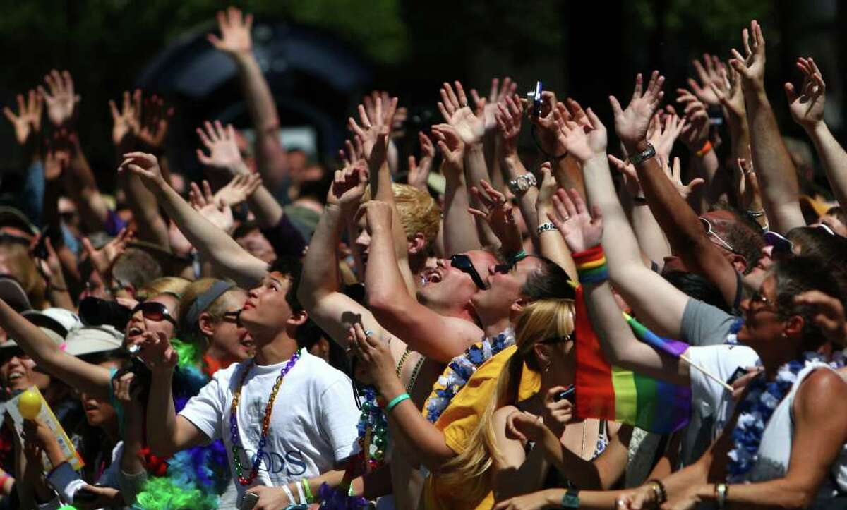 Spectators cheer during the 2011 Seattle Pride Parade. Seattle has a record of backing gay rights that goes back 35 years.