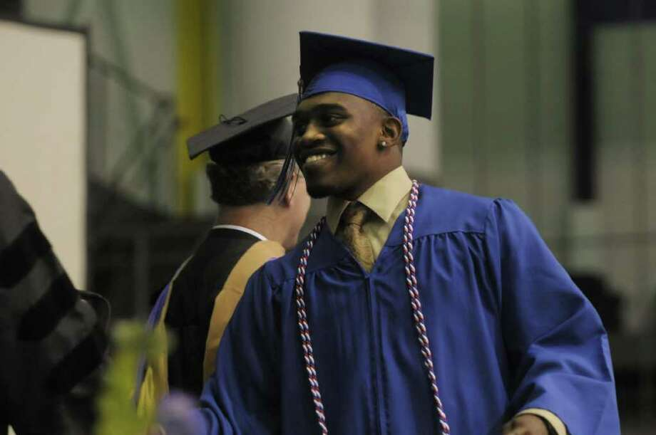 Graduate Shamar Bell walks up to receive his diploma during the Albany High School commencement at the SEFCU Arena on the campus of the University at Albany.  A total of 449 students graduated and close to 90% plan to attend college.   (Paul Buckowski / Times Union) Photo: Paul Buckowski / 00013594A