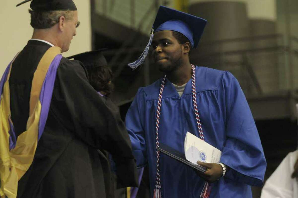 Graduate Jason Brooks walks up to receive his diploma during the Albany High School commencement at the SEFCU Arena on the campus of the University at Albany. A total of 449 students graduated and close to 90% plan to attend college. (Paul Buckowski / Times Union)