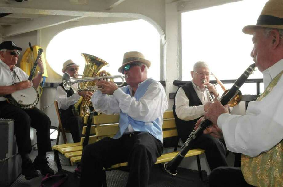 Members of the Hedge Fund Rascals Dixieland jazz from left: Gim Burton, of Ridgefield, banjo; Joe Hanchrow, of New City, N.Y., tuba; Tom Keegan, of New City, N.Y., trumpet; Peter Ballance, of Montclair, N.J., tromdone; and Quentin Solano, of Mamaroneck, N.Y., clarnet at Island Beach ferry on Sunday, June 26, 2011. This is the first Jazz on the Sound Concert of the summer. Photo: Helen Neafsey / Greenwich Time