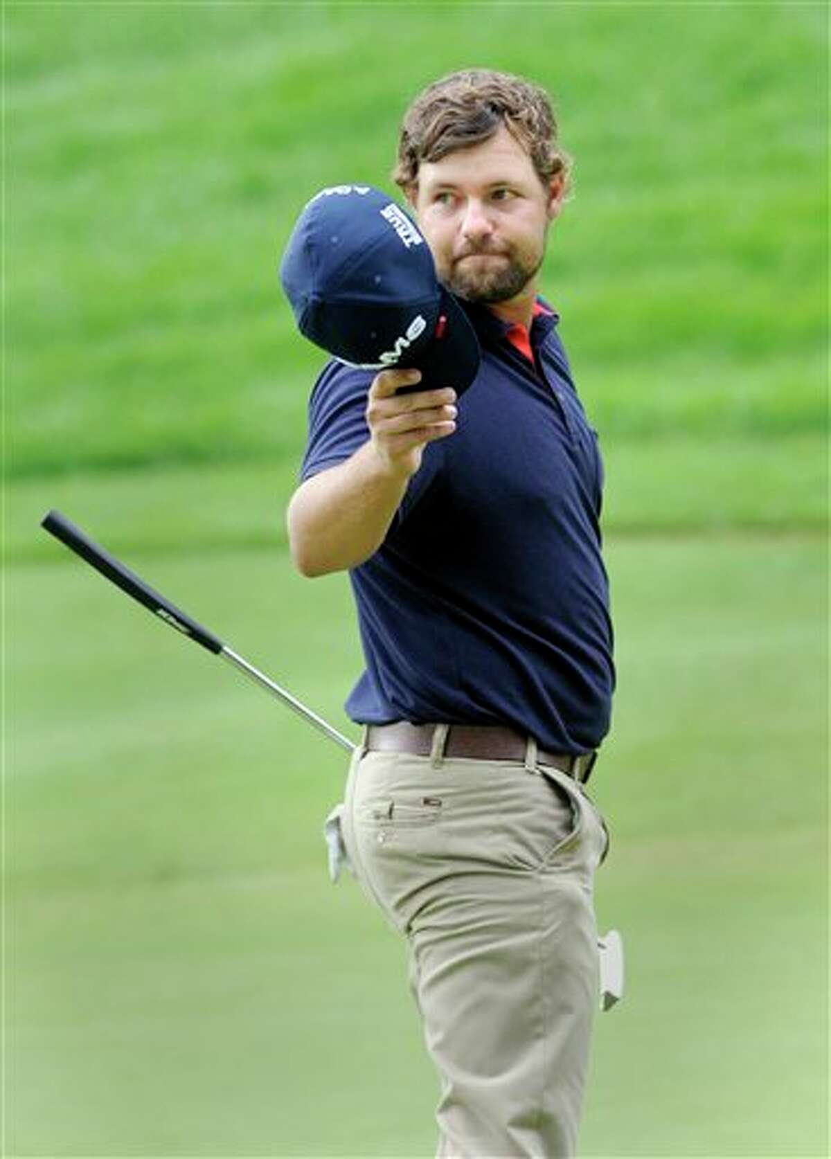 Ryan Moore reacts after his bogey on the 18th hole during the final round of the Travelers Championship golf tournament in Cromwell, Conn., on Sunday, June 26, 2011. Moore's bogey on the hole knocked him out of a tie for first, he finished the tournament 19-under par in a two way tie for second. (AP Photo/Fred Beckham)