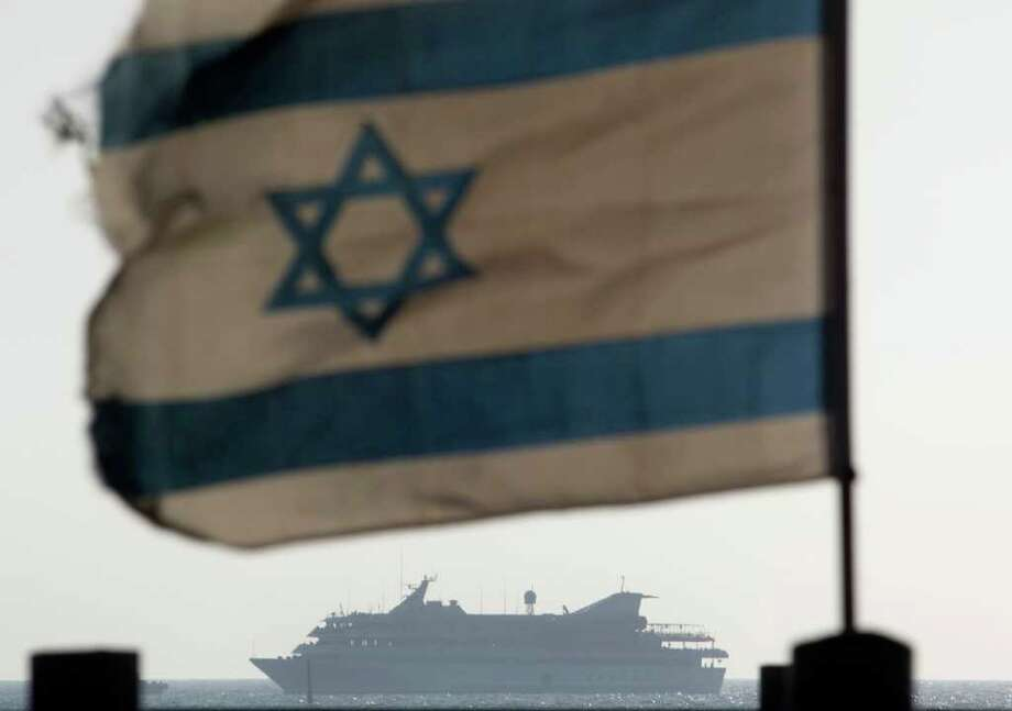FILE - In this May 31, 2010 file photo the Mavi Marmara ship, the lead boat of a flotilla headed to the Gaza Strip which was stormed by Israeli naval commandos in a predawn confrontation, sails into the port of Ashdod, Israel. Israel on Sunday, June 26, 2011, threatened to ban international journalists for up to a decade from the country if they join a flotilla planning to breach the Israeli blockade of the Gaza Strip. (AP Photo/Ariel Schalit, File) Photo: Ariel Schalit / AP