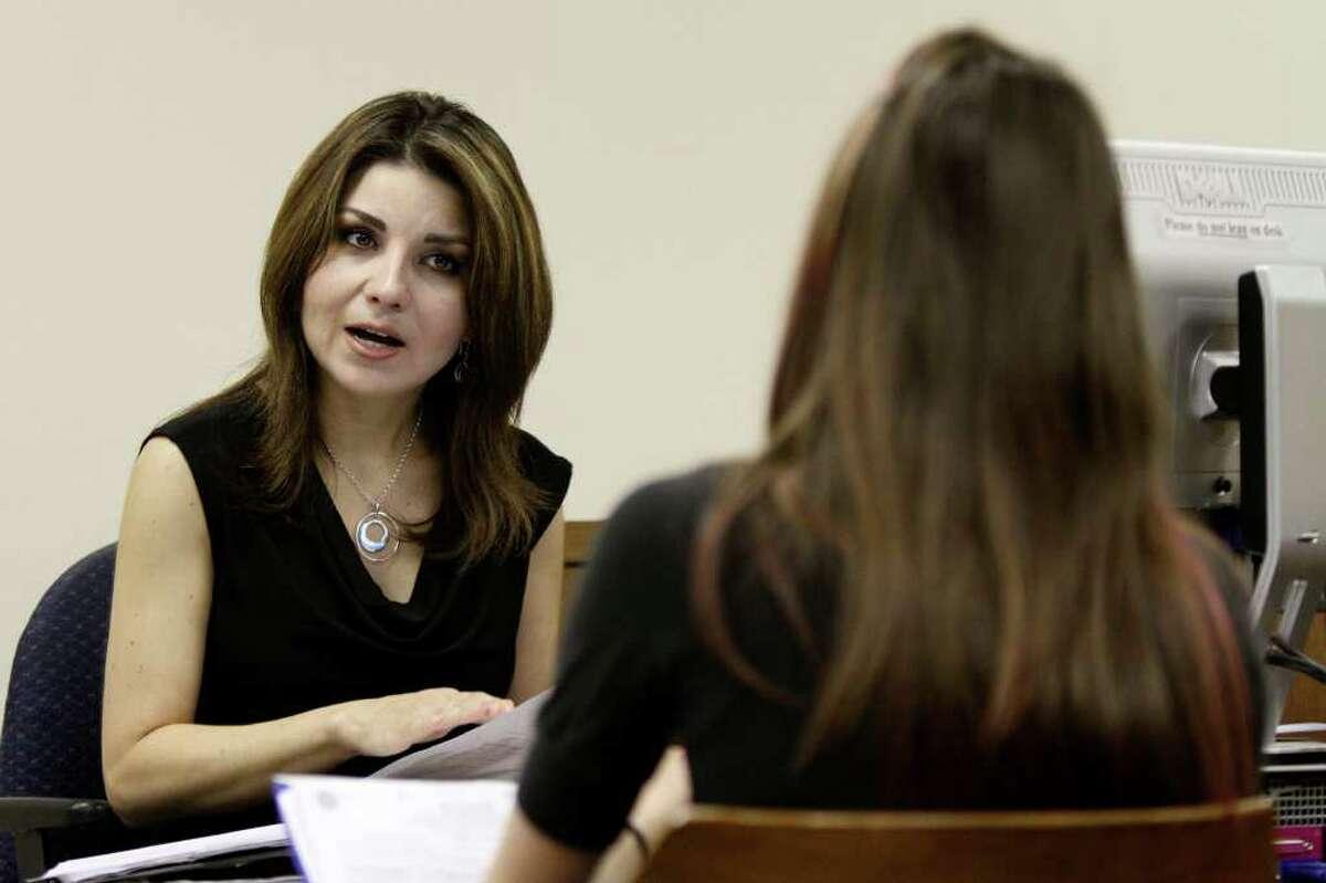Assistant city attorney Elizabeth Yetman discusses citations with a defendant at the San Antonio Municipal Court Building.