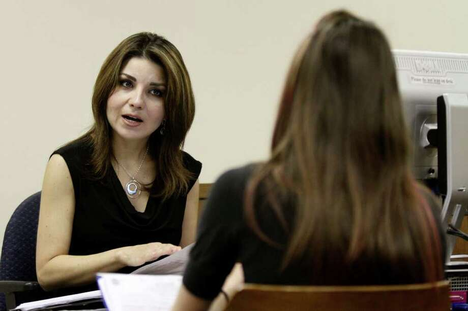 Assistant city attorney Elizabeth Yetman discusses citations with a defendant at the San Antonio Municipal Court Building. Photo: Andrew Buckley/abuckley@express-news.net / SAN ANTONIO EXPRESS-NEWS