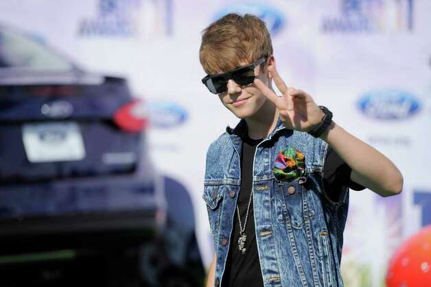Justin Bieber arrives at the BET Awards on Sunday, June 26, 2011, in Los Angeles. (AP Photo/Chris Pizzello) Photo: Chris Pizzello, STF / AP