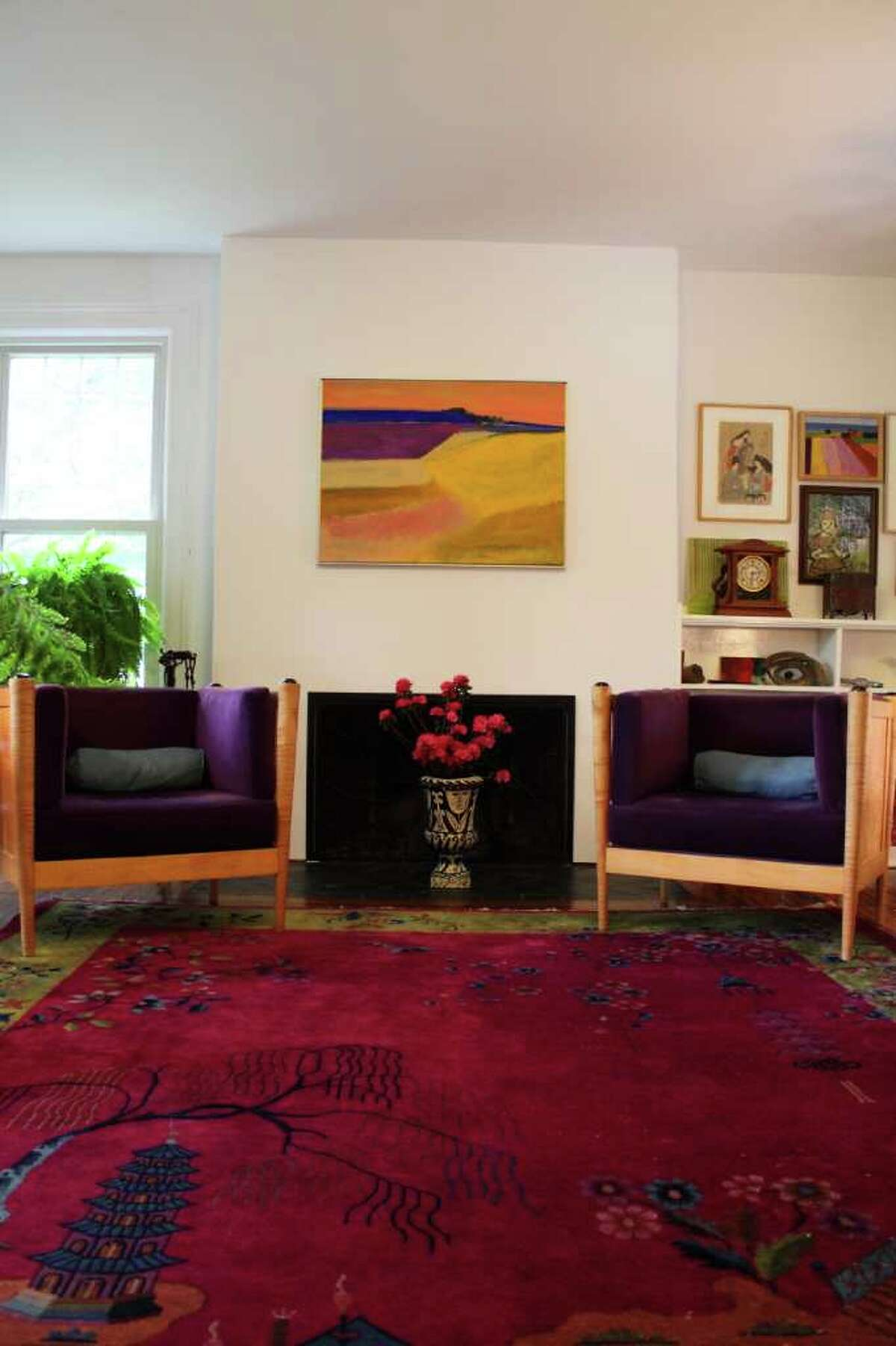 An encounter with a Hudson River School artist's colorful work inspired Kristina Almquist and Greg Pattison's bold decor. (Photos by Nancy Bruno/Life@Home) Click here to read the story.