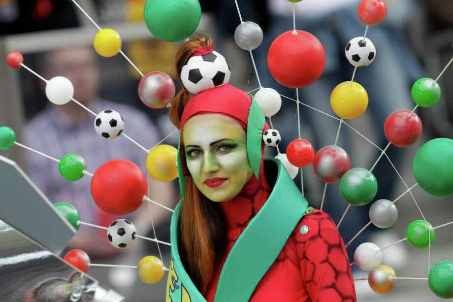 A fan wearing a colourful dress wait for the beginning of the group A match between Germany and Canada at the Women's Soccer World Cup in Berlin, Germany, Sunday, June 26, 2011. (AP Photo/Michael Sohn) Photo: Michael Sohn