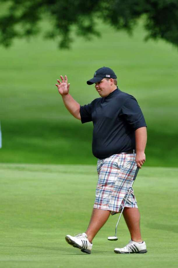Don DeNyse, III acknowledges applause after sinking a birdie putt on the 14th hole en route to winning the Troy Invitational at the Country Club of Troy on Sunday  June 26, 2011 in Troy, NY.   ( Philip Kamrass / Times Union) Photo: Philip Kamrass