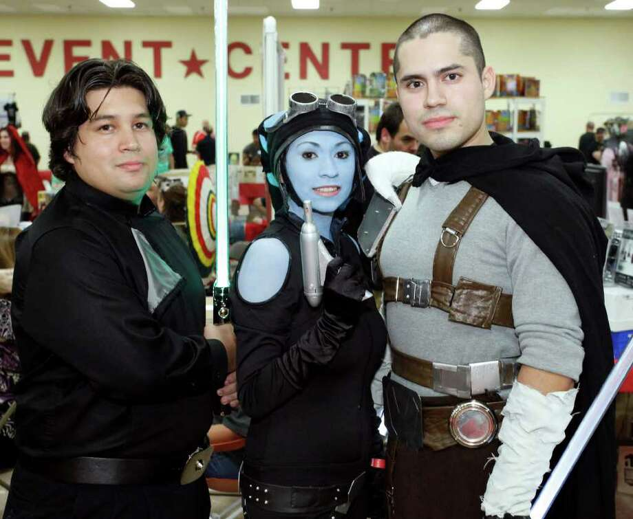 Robert Holguin III (from left) and Maggie and Nick Sanchez visit Texas Comicon on Friday, June 24, 2011, at the San Antonio Events Center. Photo: J. Michael Short/Special To The Express-News / THE SAN ANTONIO EXPRESS-NEWS