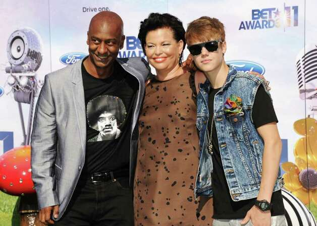 LOS ANGELES, CA - JUNE 26: (L-R) BET President, Music Programming and Specials Stephen Hill, CEO of BET Debra Lee and singer Justin Bieber arrive at the BET Awards '11 held at the Shrine Auditorium on June 26, 2011 in Los Angeles, California. Photo: Jason Merritt, Getty Images / 2011 Getty Images