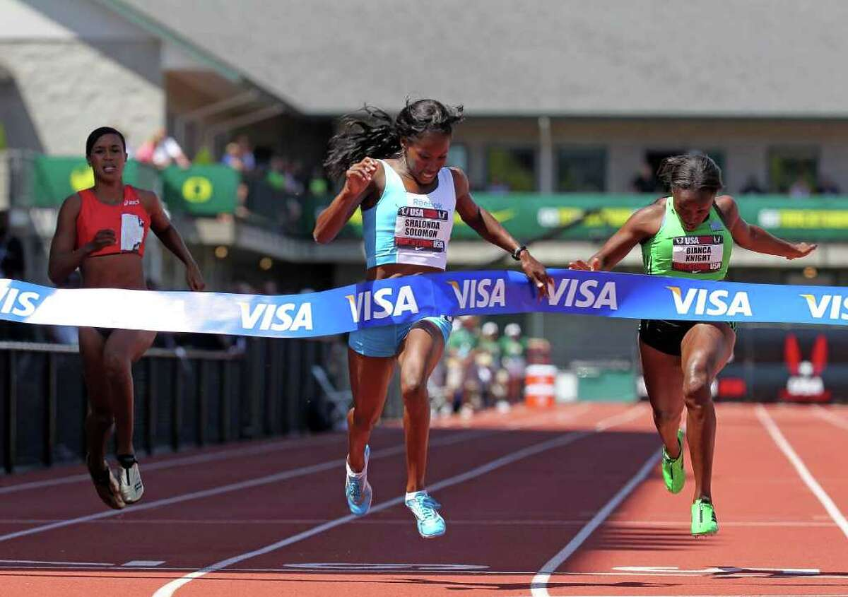 Shalonda Solomon crosses the finish line to win the women's 200 meters.