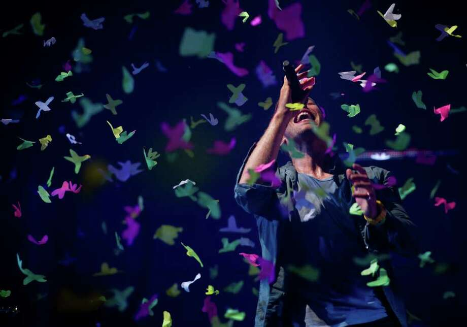 GLASTONBURY, ENGLAND - JUNE 25: Chris Martin of Coldplay performs live on the pyramid stage during the Glastonbury Festival at Worthy Farm, Pilton on June 25, 2011 in Glastonbury, England.  (Photo by Ian Gavan/Getty Images) Photo: Ian Gavan, Getty Images / 2011 Getty Images