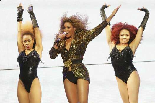 GLASTONBURY, ENGLAND - JUNE 26:  (UK TABLOID NEWSPAPERS OUT) Beyonce Knowles performs at the Glastonbury Festival at Worthy Farm, Pilton on June 26, 2011 in Glastonbury, England. The festival, which started in 1970 when several hundred hippies paid 1 GBP to watch Marc Bolan, has grown into Europe's largest music festival attracting more than 175,000 people over five days.  (Photo by Dave Hogan/Getty Images) Photo: Dave Hogan, Getty Images / 2011 Getty Images