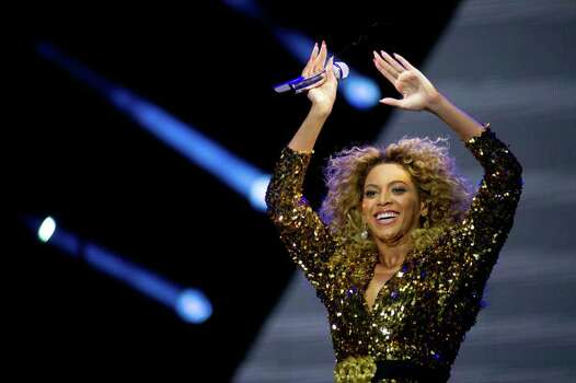 GLASTONBURY, ENGLAND - JUNE 26: Beyonce performs live on the pyramid stage during the Glastonbury Festival at Worthy Farm, Pilton on June 26, 2011 in Glastonbury, England. The festival, which started in 1970 when several hundred hippies paid 1 GBP to attend, has grown into Europe's largest music festival attracting more than 175,000 people over five days.  (Photo by Ian Gavan/Getty Images) Photo: Ian Gavan, Getty Images / 2011 Getty Images