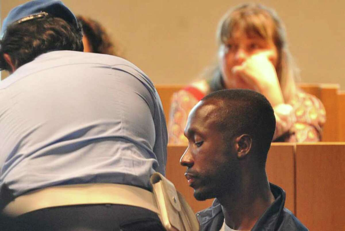 Rudy Guede, convicted of killing a British student, testimonifies against Amanda Knox on Monday in Perugia, Italy. AFP PHOTO / ALBERTO PIZZOLI