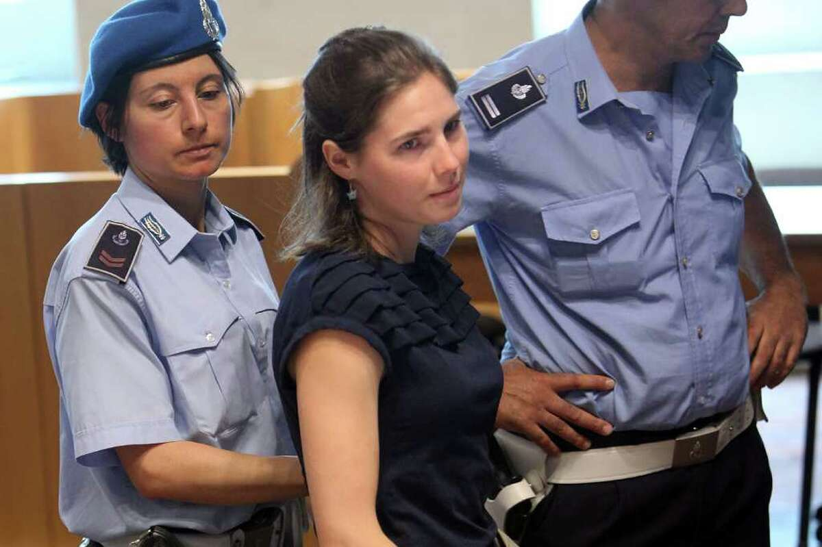 PERUGIA, ITALY - JUNE 27: Amanda Knox arrives in Perugia's court of Appeal during the hearing of her appeal against her murder conviction on June 27, 2011 in Perugia, Italy. American Amanda Knox and her Italian ex-boyfriend Raffaele Sollecito were convicted of the murder of Ms Knox's former British flatmate Meredith Kercher in 2007. Their trial took place in December 2009 with Knox and Sollecito receiving sentences of 26 and 25 years respectively. Rudy Guede, an unemployed man from Ivory Coast, was also convicted of the Meredith Kercher's murder.