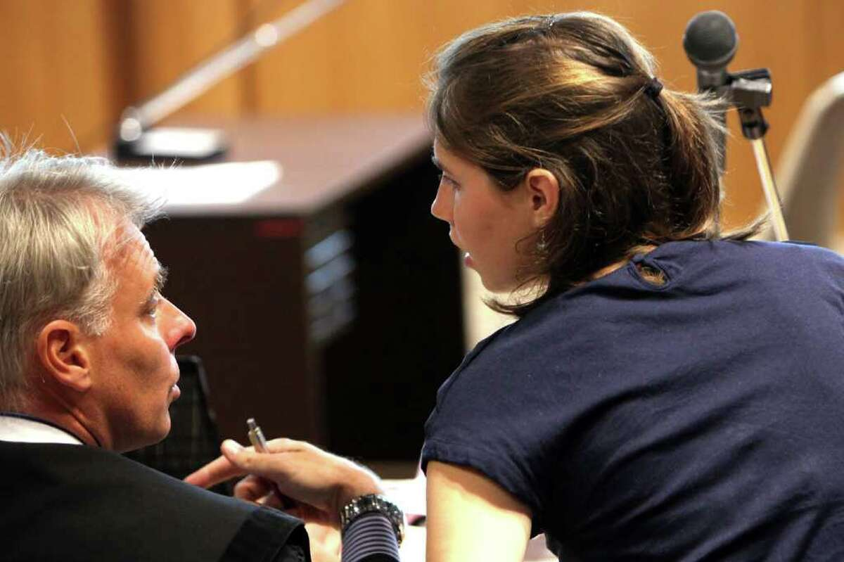 PERUGIA, ITALY - JUNE 27: Amanda Knox speaks with her legal Carlo Dalla Vedova in Perugia's court of Appeal during the first session of her appeal against her murder conviction on June 27, 2011 in Perugia, Italy. American Amanda Knox and her Italian ex-boyfriend Raffaele Sollecito were convicted of the murder of Ms Knox's former British flatmate Meredith Kercher in 2007. Their trial took place in December 2009 with Knox and Sollecito receiving sentences of 26 and 25 years respectively. Rudy Guede, an unemployed man from Ivory Coast, was also convicted of the Meredith Kercher's murder.