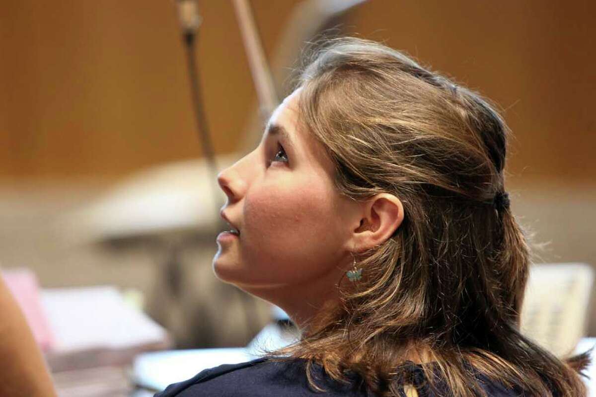 PERUGIA, ITALY - JUNE 27: Amanda Knox sits in Perugia's Court of Appeal during the hearing of her appeal against her murder conviction on June 27, 2011 in Perugia, Italy. American Amanda Knox and her Italian ex-boyfriend Raffaele Sollecito were convicted of the murder of Ms Knox's former British flatmate Meredith Kercher in 2007. Their trial took place in December 2009 with Knox and Sollecito receiving sentences of 26 and 25 years respectively. Rudy Guede, an unemployed man from Ivory Coast, was also convicted of the Meredith Kercher's murder.