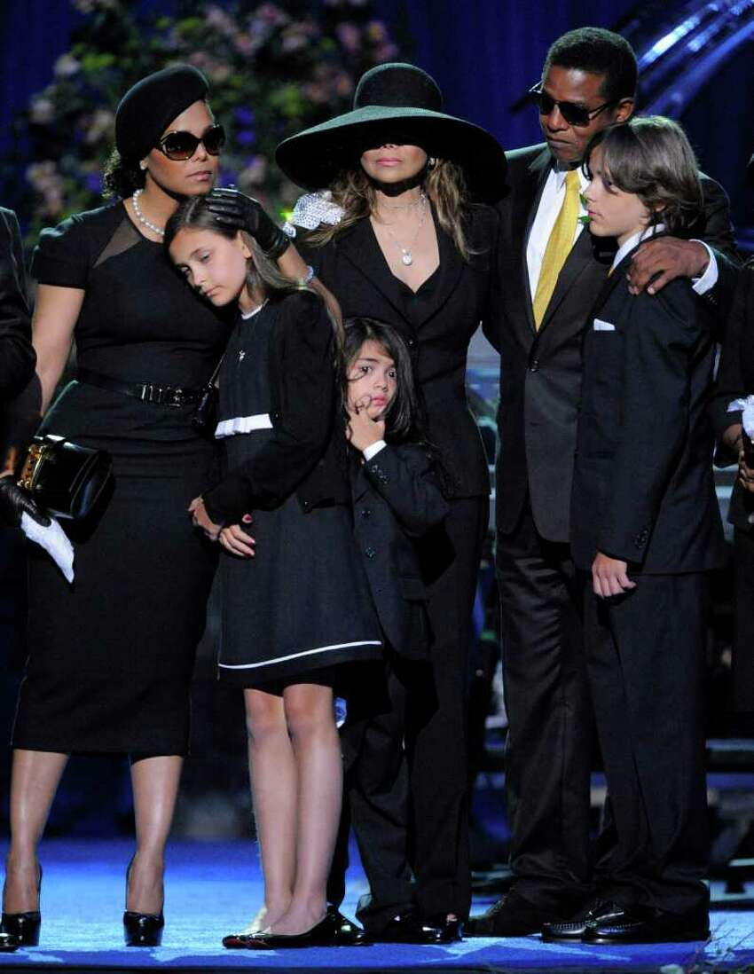 Singer Janet Jackson, left, Paris Jackson, La Toya Jackson, Randy Jackson and Prince Michael I on stage during the memorial service for Michael Jackson at the Staples Center in Los Angeles, Tuesday, July 7, 2009.