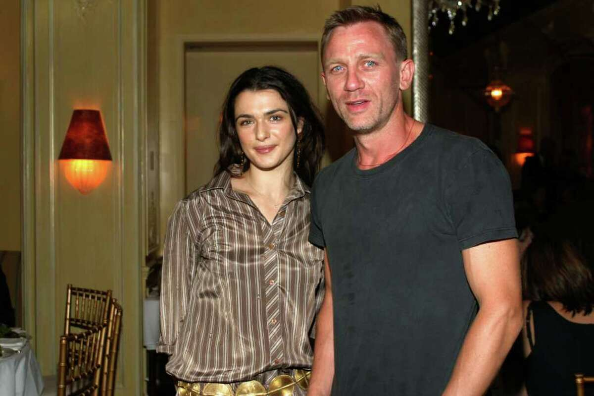 """James Bond has finally settled down, sort of. Current Bond actor Daniel Craig, 43, married fellow actor Rachel Weisz, 41, in a ceremony attended only by Craig's 18-year-old daughter, Ella, Rachel's 4-year-old son, Henry, and two family friends, the U.K. Daily Mail reported Monday. The couple have been friends for years but only got romantic after getting cast as husband and wife in the forthcoming movie """"The Dream House,"""" the Daily Mail said. Weisz was previously engaged to Black Swan director Darren Aronovsky, Henry's dad, while Craig had been engaged long-term girlfriend Satsuki Mitchell. Here are Weisz and Craig at a private screening of """"Enduring Love"""" on September 13, 2004 in New York City."""