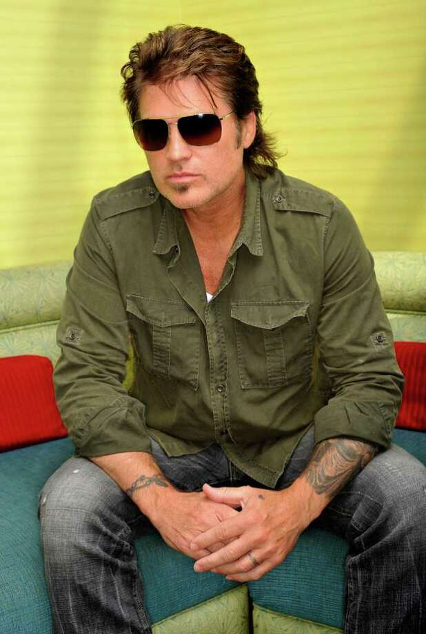 """This June 8, 2011 photo shows country music performer Billy Ray Cyrus in Nashville, Tenn. Ray's latest album, """"I'm American,"""" will be released on Tuesday, June 28. (AP Photo/ Donn Jones) Photo: Donn Jones"""
