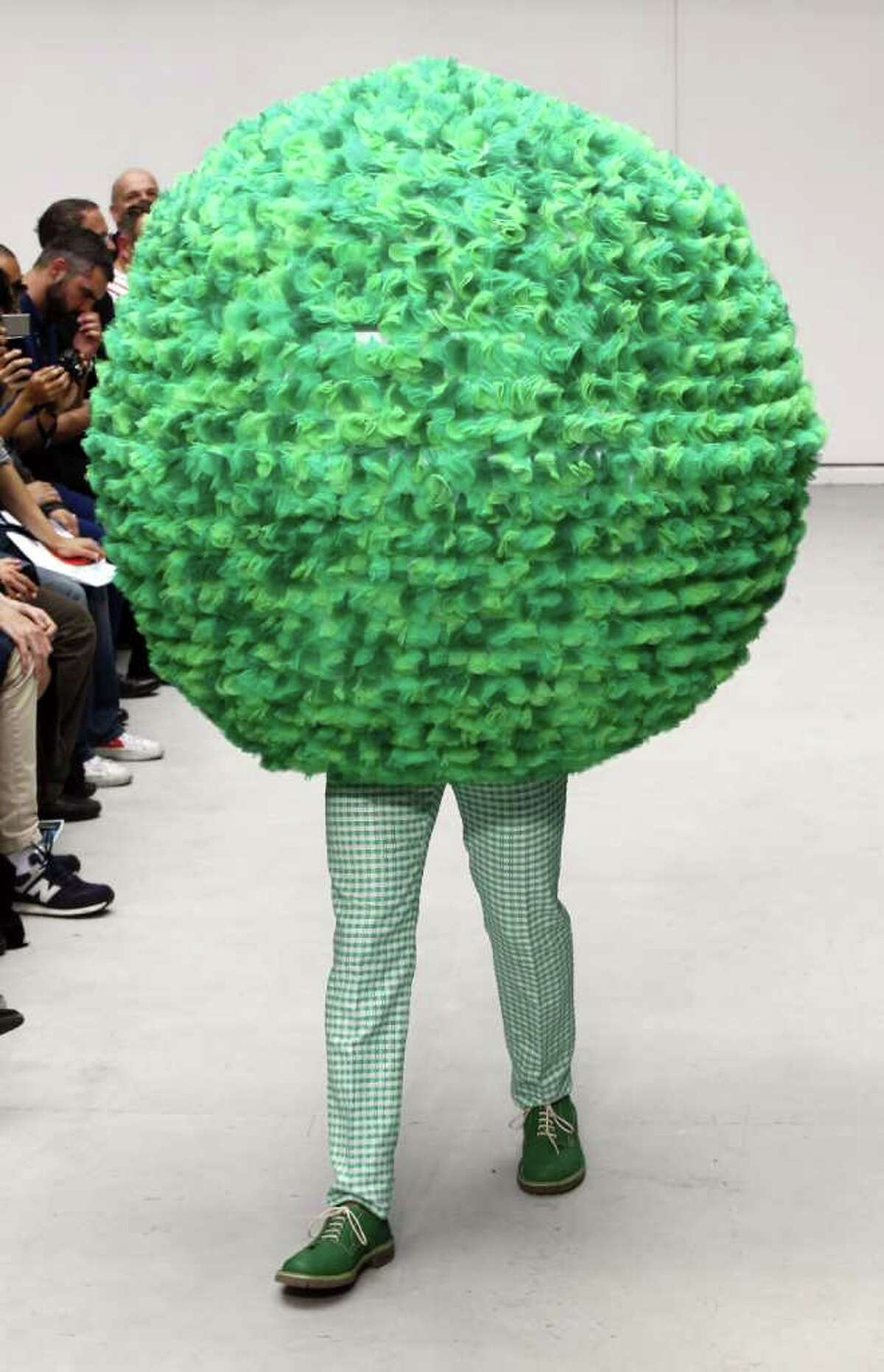 A model displays a creation by Belgian fashion designer Walter Van Beirendonck during his men's spring-summer 2012 fashion collection show on June 24, 2011 in Paris.