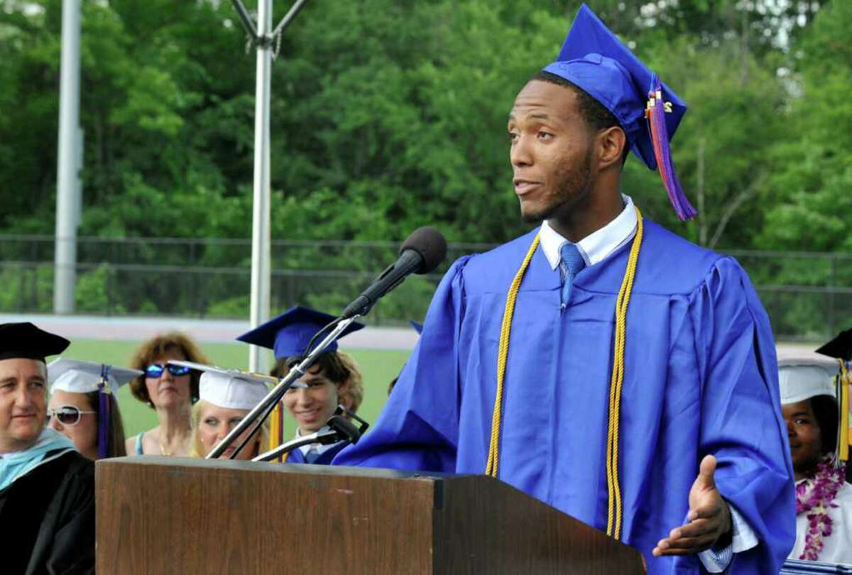 Class president Deyon Rosado makes a statement for the students at Danbury High School during commencement exercises on Monday, June 27, 2011.