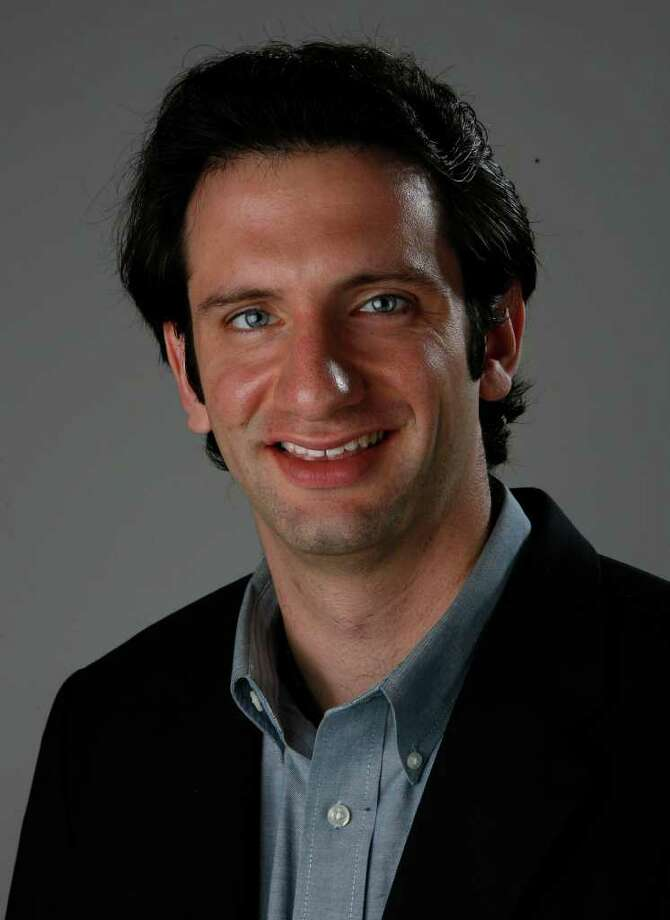Zachary Levine, sports writer for the Houston Chronicle, poses for a company photo on Tuesday, Oct. 13, 2009, in Houston. ( Julio Cortez / Chronicle ) Photo: Julio Cortez / Houston Chronicle