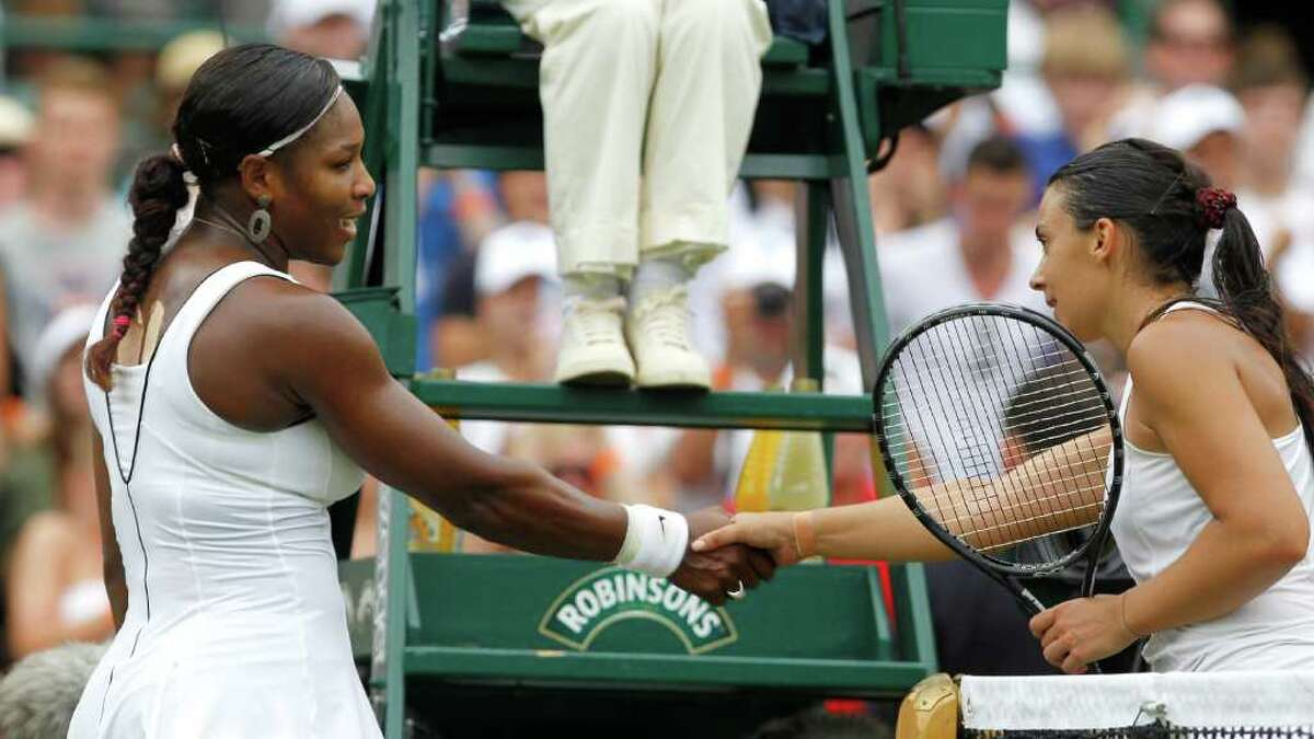 France's Marion Bartoli, right, shakes hands after defeating Serena Williams of the US in their match at the All England Lawn Tennis Championships at Wimbledon, Monday, June 27, 2011. (AP Photo/Anja Niedringhaus)