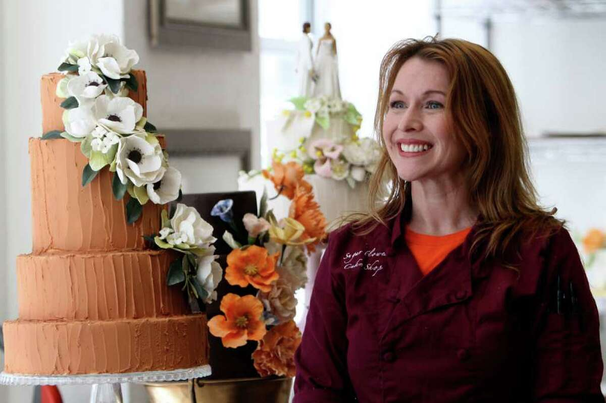 Amy DeGiulio owner of Sugar Flower Cake Shop smiles during an interview with the Associated Press, Monday, June 27, 2011 in New York. (AP Photo/Mary Altaffer)