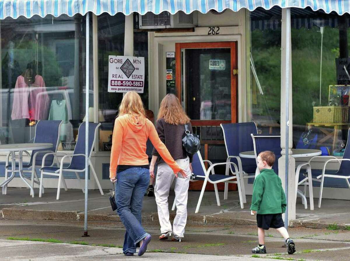 Shoppers pass by the now closed North Creek Deli and Market on Main Street in North Creek Wednesday June 22, 2011. (John Carl D'Annibale / Times Union)