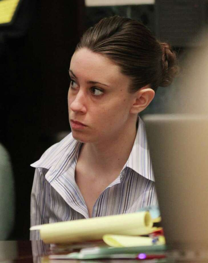 Casey Anthony sits at the defense table  before the start of her murder trial at the Orange County Courthouse in Orlando, Fla. on Friday, June 24, 2011. Anthony, 25, is charged with the murder of her 2-year old daughter in 2008.(AP Photo/Red Huber,Pool) Photo: Red Huber