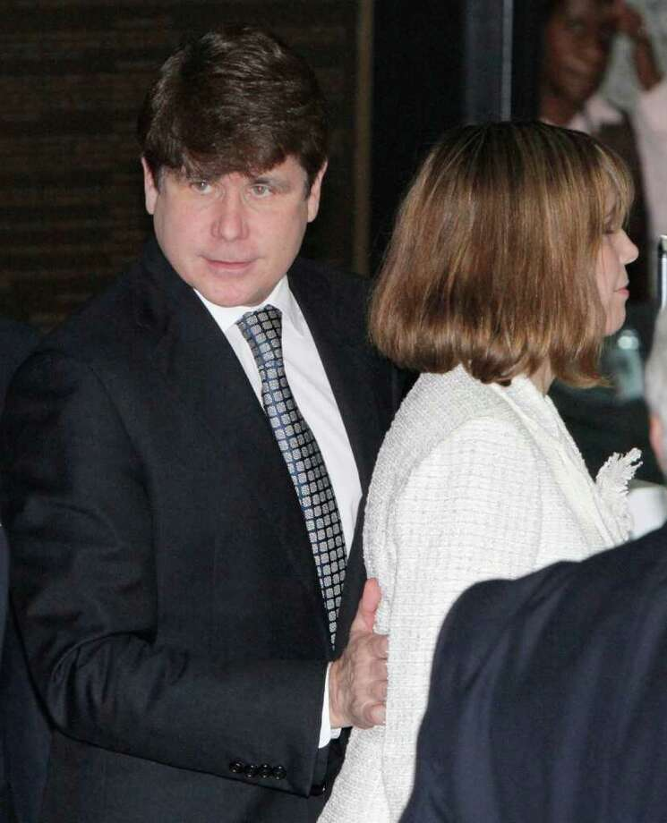 Former Illinois Gov. Rod Blagojevich arrives at the Federal courthouse with his wife Patti Monday, June 27, 2011 in Chicago after jurors informed the judge that they had reached agreement on 18 of the 20 counts against him.  (AP Photo/M. Spencer Green) Photo: M. Spencer Green