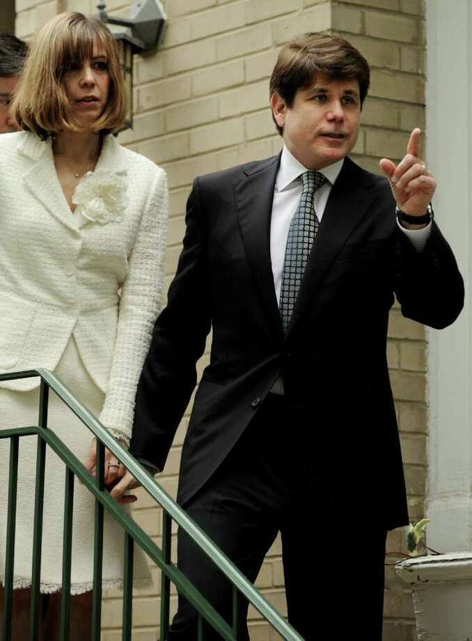 Former Illinois Gov. Rod Blagojevich and his wife, Patti, leaves their home Monday, June 27, 2011, in Chicago heading to the federal court after jurors informed the judge that they had reached agreement on 18 of the 20 counts against him in his corruption retrial. (AP Photo/Paul Beaty) Photo: Paul Beaty