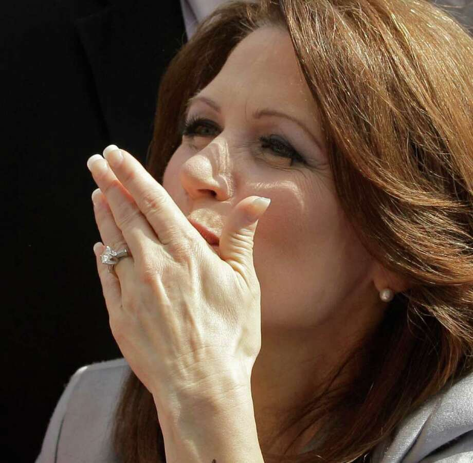 Rep. Michele Bachmann, R-Minn., blows a kiss to a supporter after her formal announcement to seek the 2012 Republican presidential nomination, Monday, June 27, 2011, in Waterloo, Iowa. Bachmann, who was born in Waterloo, will continue her announcement tour this week with stops in New Hampshire and South Carolina. (AP Photo/Charlie Riedel) Photo: Charlie Riedel