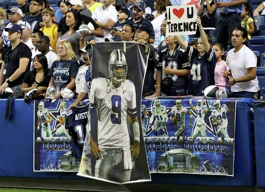 Fans cheer the Cowboys at last summer's Alamodome training camp. Will the Cowboys be here in a month? Kin Man Hui/kmhui@express-news.net Photo: KIN MAN HUI, Kin Man Hui/Express-News / San Antonio Express-News