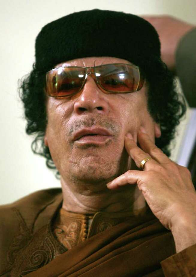 FILE.- This Friday, March 2, 2007 file photo shows Libya's Moammar Gadhafi  in Sabha, Libya Friday, March 2, 2007. The International Criminal Court issued arrest warrants Monday June 27, 2011, for Libyan leader Moammar Gadhafi, his son and his intelligence chief for crimes against humanity in the early days of their struggle to cling to power. (AP Photo/Nasser Nasser, File) Photo: Nasser Nasser / AP