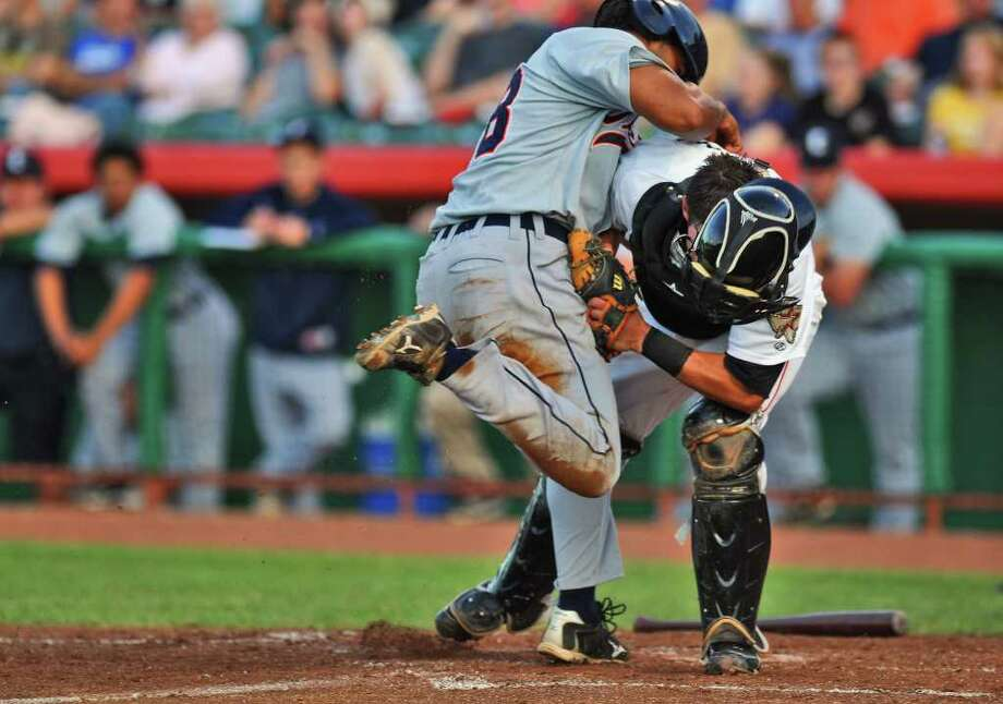 Tri City Valley Cats catcher Bubby Williams holds onto the ball as Connecticut Tigers outfielder Samir Rijo, left,  tries to knock the ball loose before being called out at home plate during the third inning of a game at Joseph Bruno Stadium on Monday night June 27, 2011 in Troy, NY.  ( Philip Kamrass / Times Union) Photo: Philip Kamrass